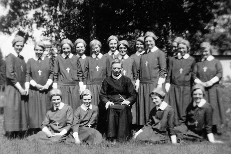 Fr. O'Hare with Sisters in Edson