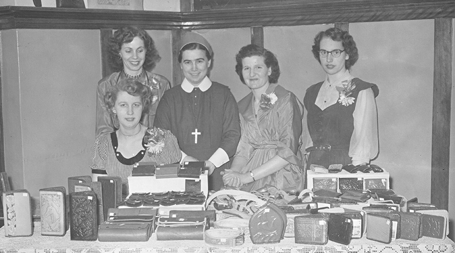 Residents with a leather craft display