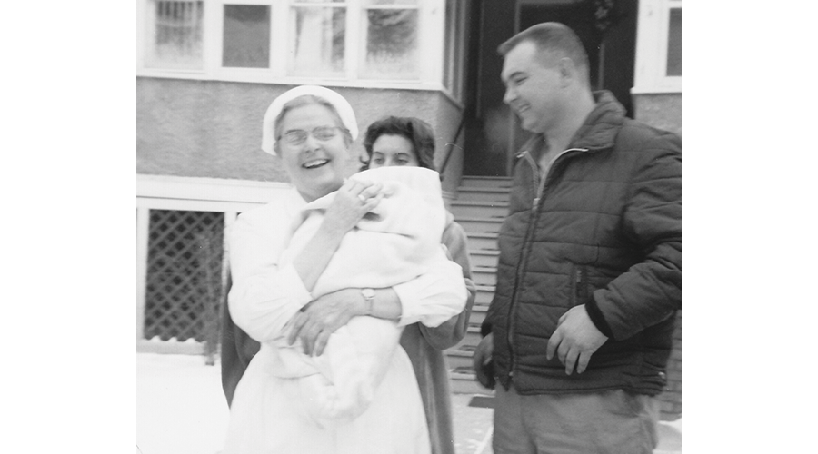 Sister Mary Quinn holds an infant