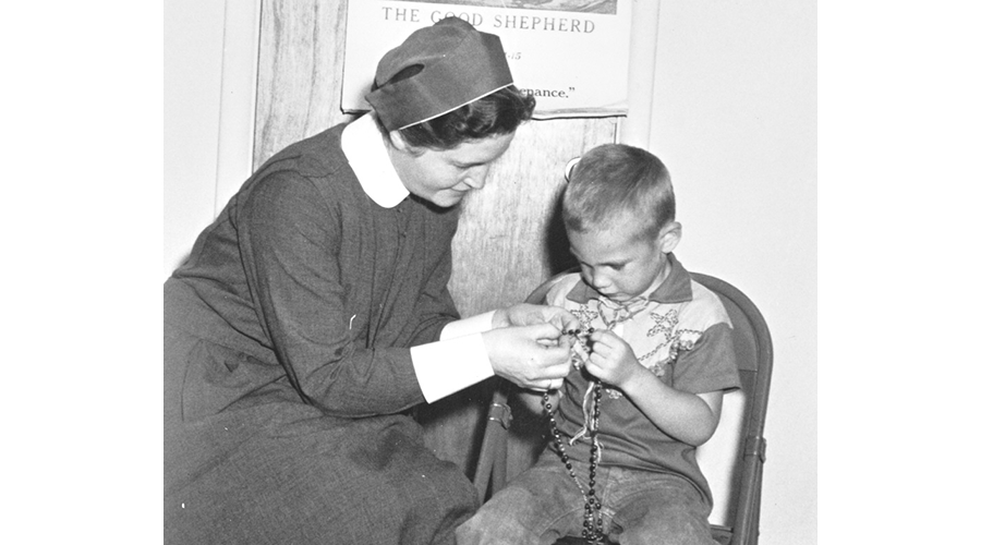 Sister Mary Harding teaches rosary