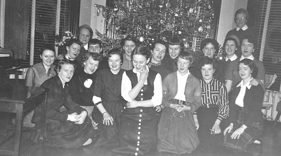 Sisters and residents in front of Christmas tree