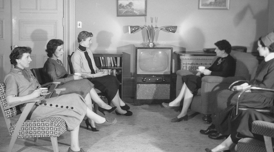 Sister Sullivan and residents watch television