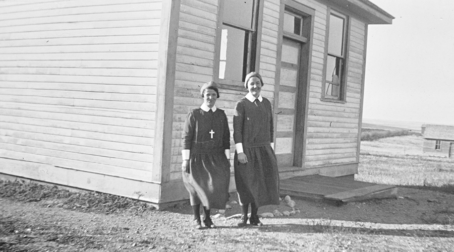 Sisters Morgan and Jackson outside a school