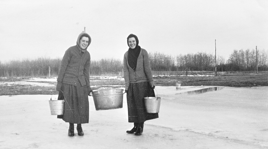 Sisters Roberts and Mossey with water pails