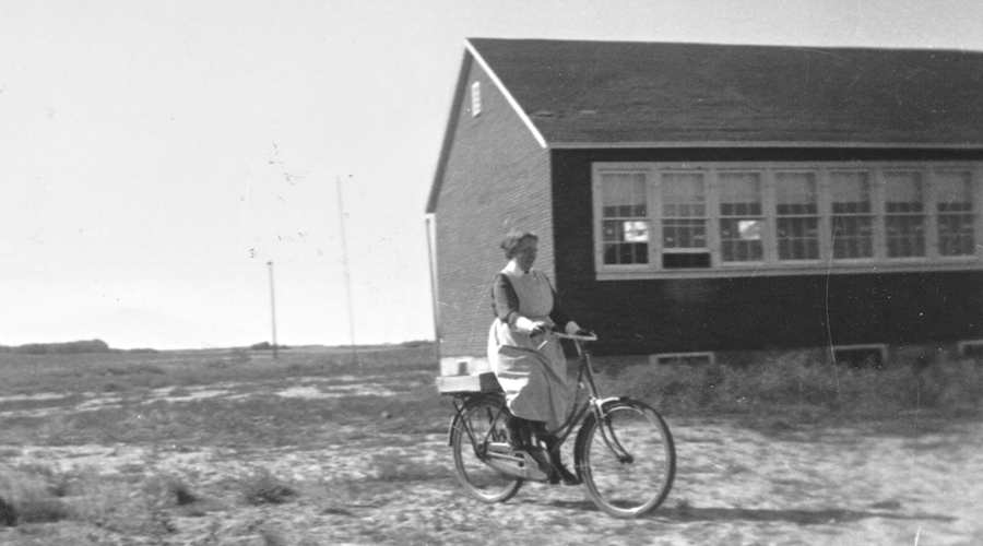 Sister Deland on bicycle