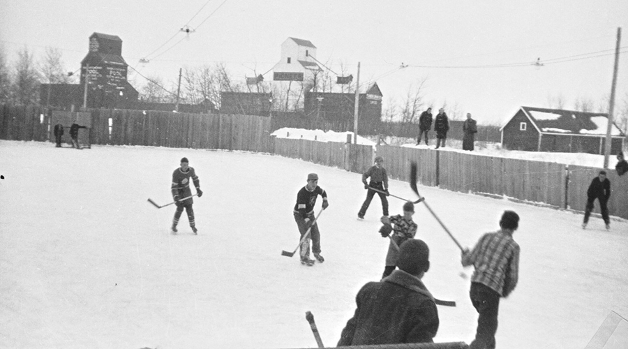 Students play hockey outdoors