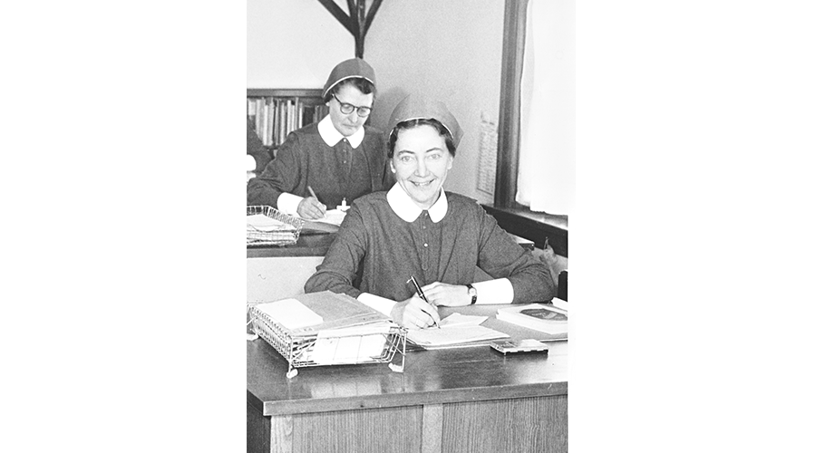 Sister Mary Jackson at her desk in Edmonton