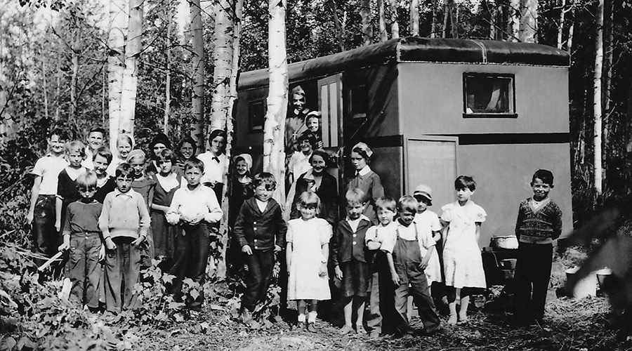 Sister Irene Faye with families at campsite