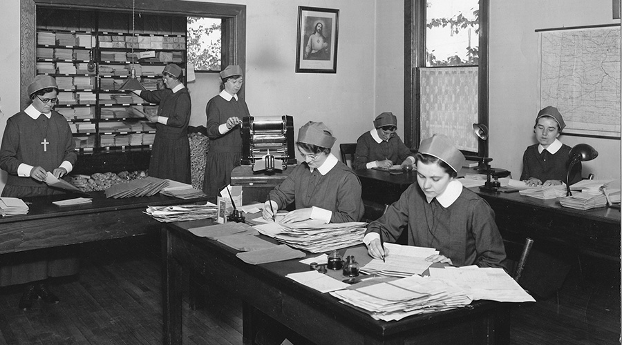 Sisters work in the office of the Religious Correspondence School, Regina